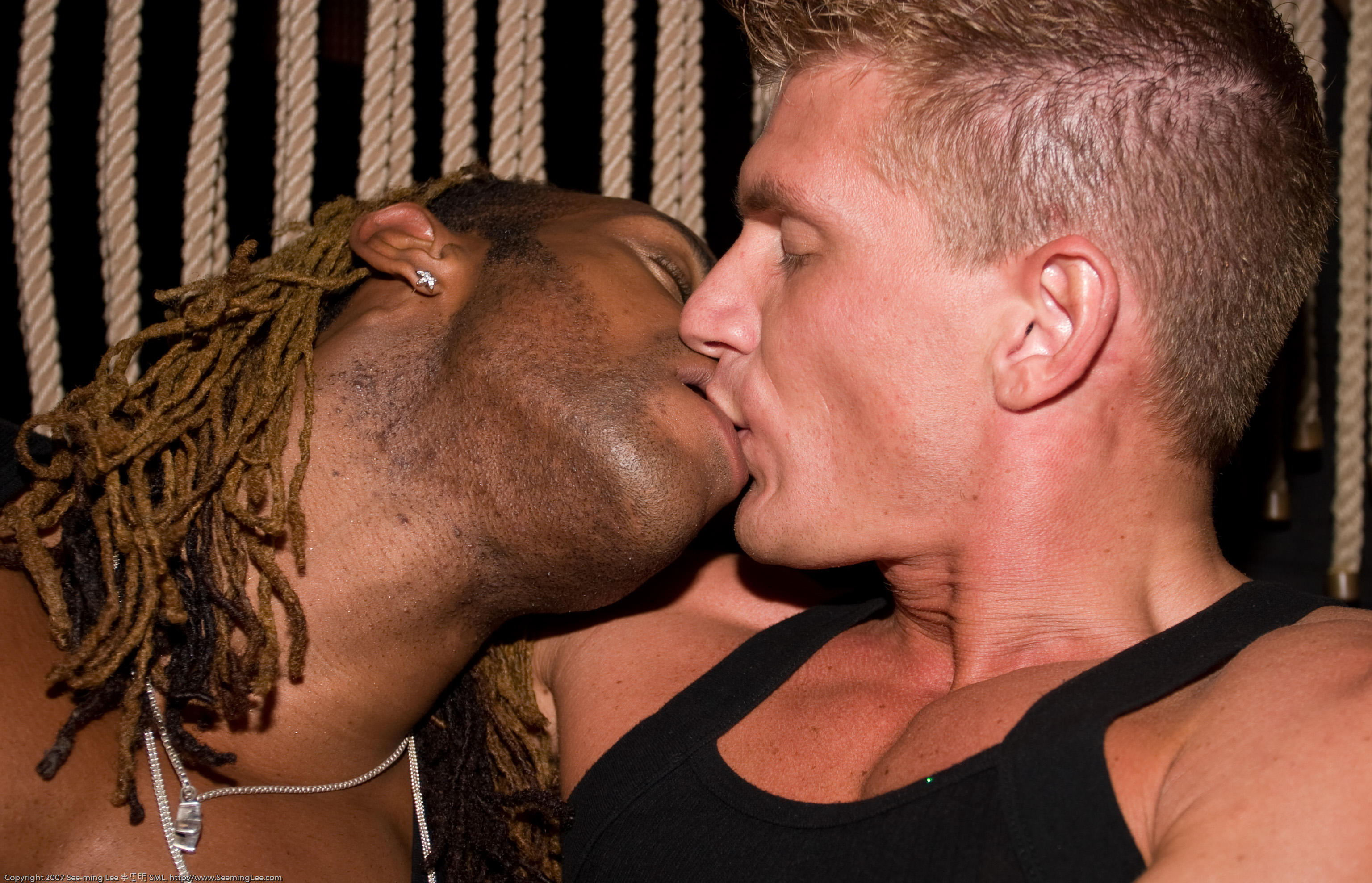 Black and white guys kissing