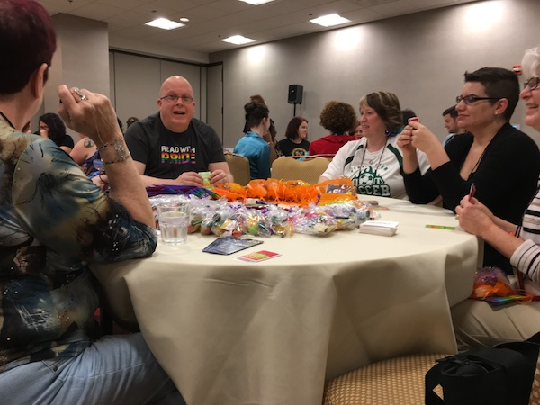 To the right of Jeff is Wade Kelly and next to her are readers at the Dreamspinner Apples to Apples event.